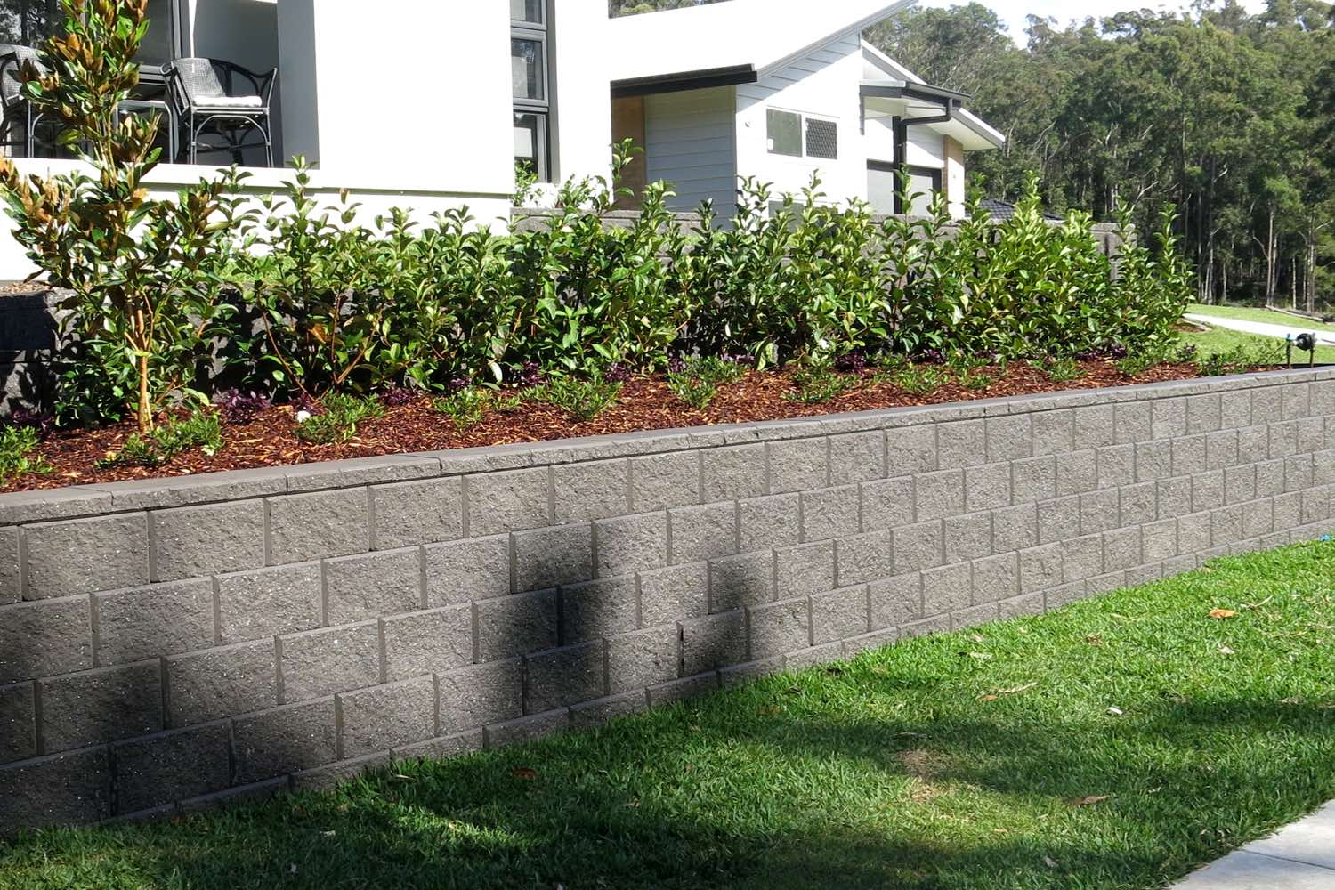 A tiered segmental block retaining wall built by Novascape at Cameron Park