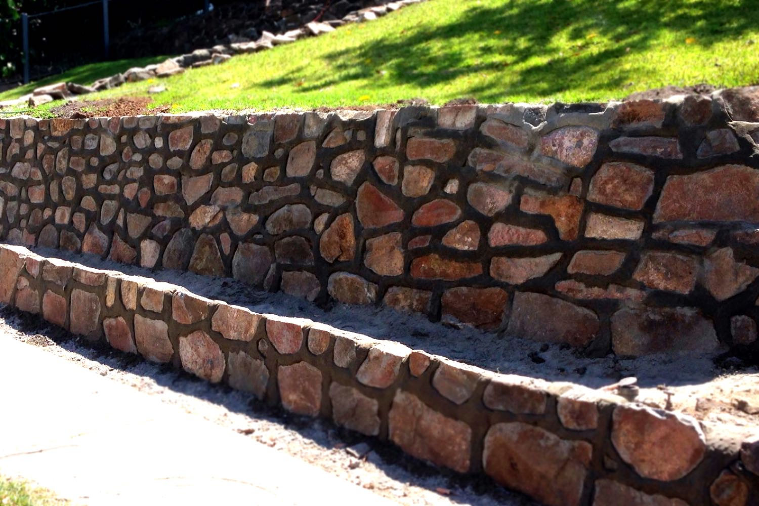 Bushrock retaining wall built by Novascape Landscaping