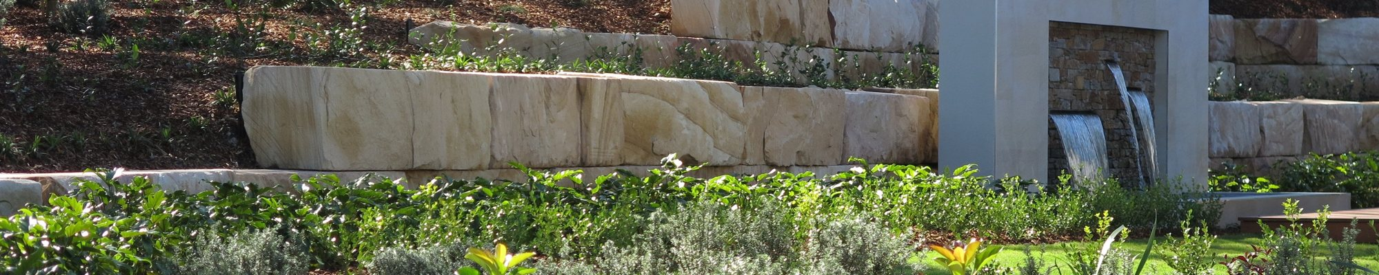 Novascape constructed this large sandstone log wall for McDonald Jones homes