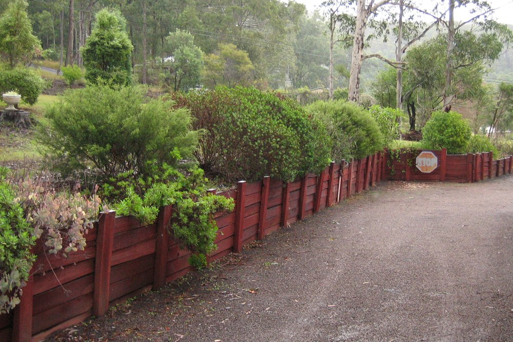 Novascape removed this deteriorating wall and replaced it with a treated pine post and rail wall