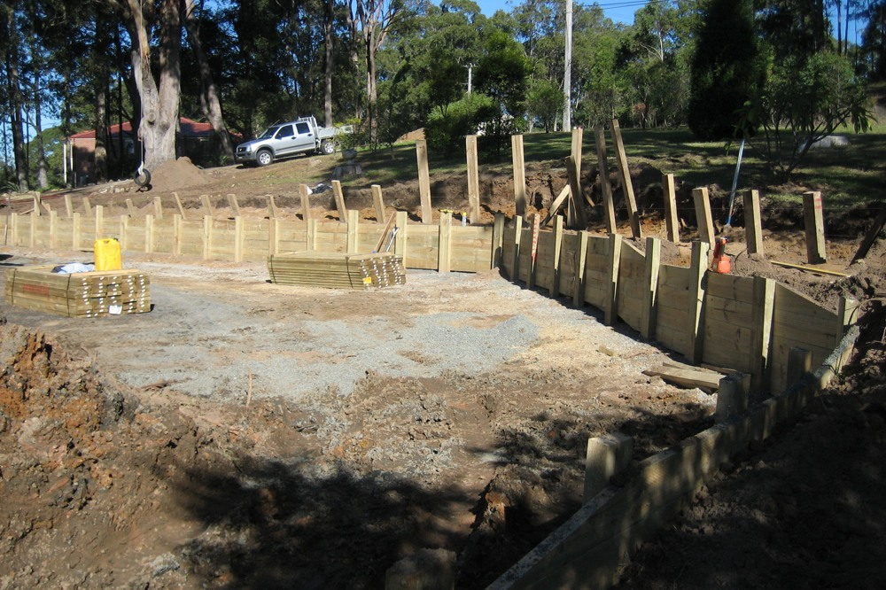 Novascape construct a treated pine post and rail retaining wall