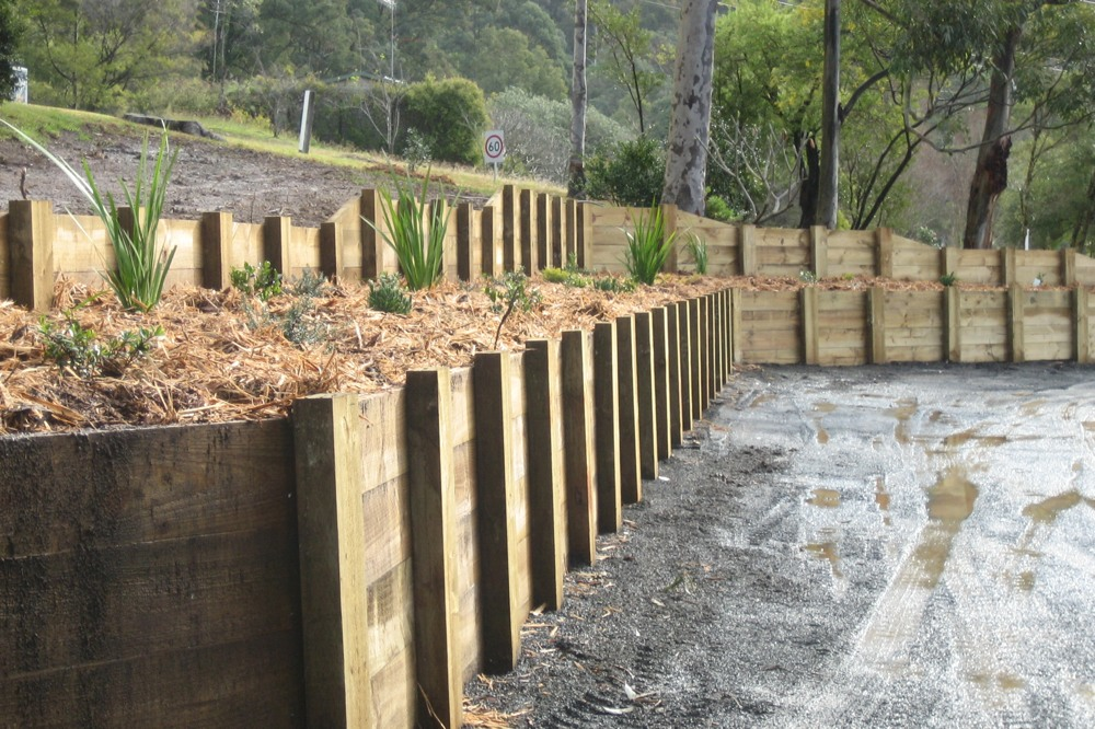 Novascape built this treated pine post and rail retaining wall