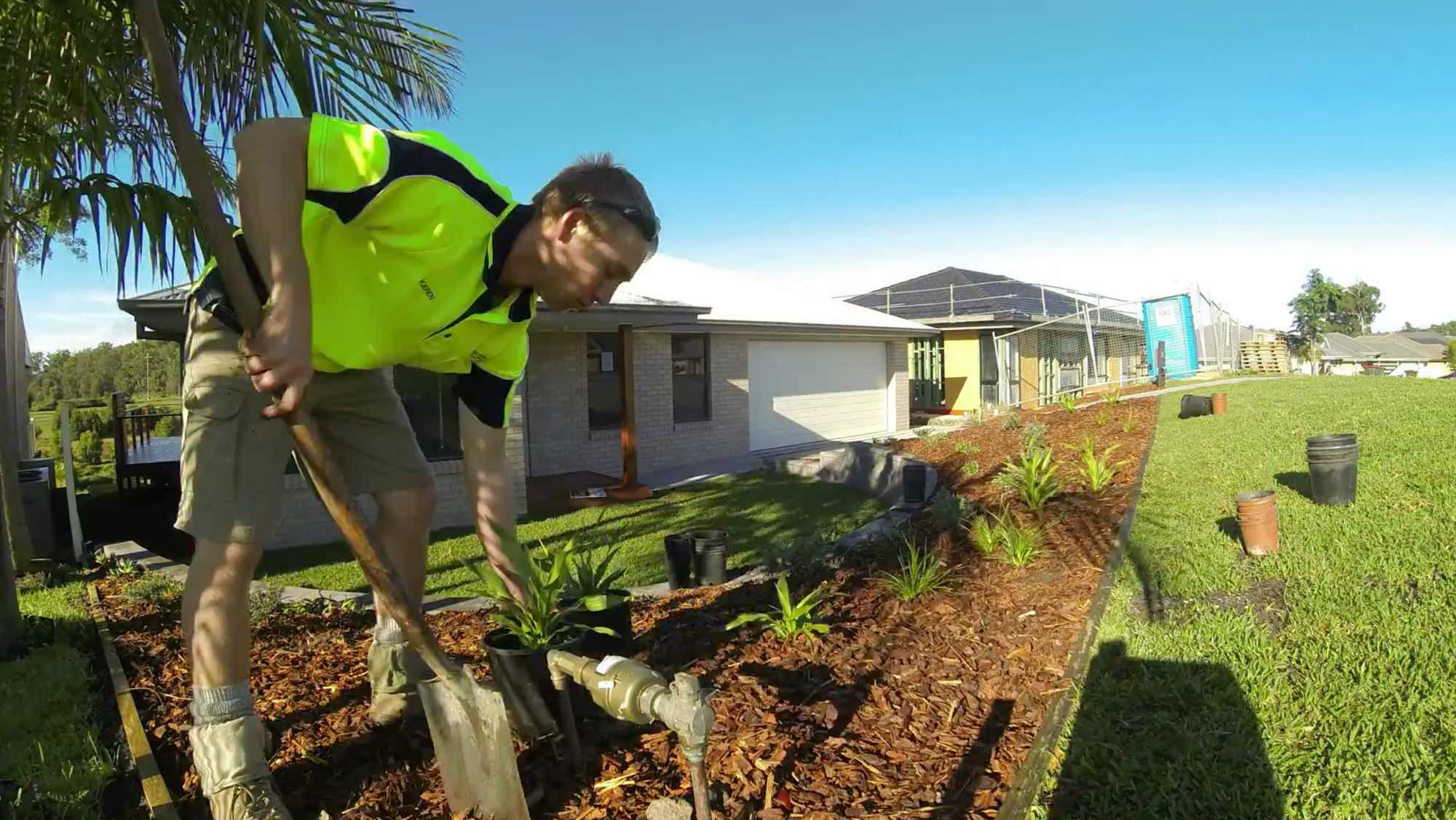 Kieren Haddow planting out Chris Gianola's front garden