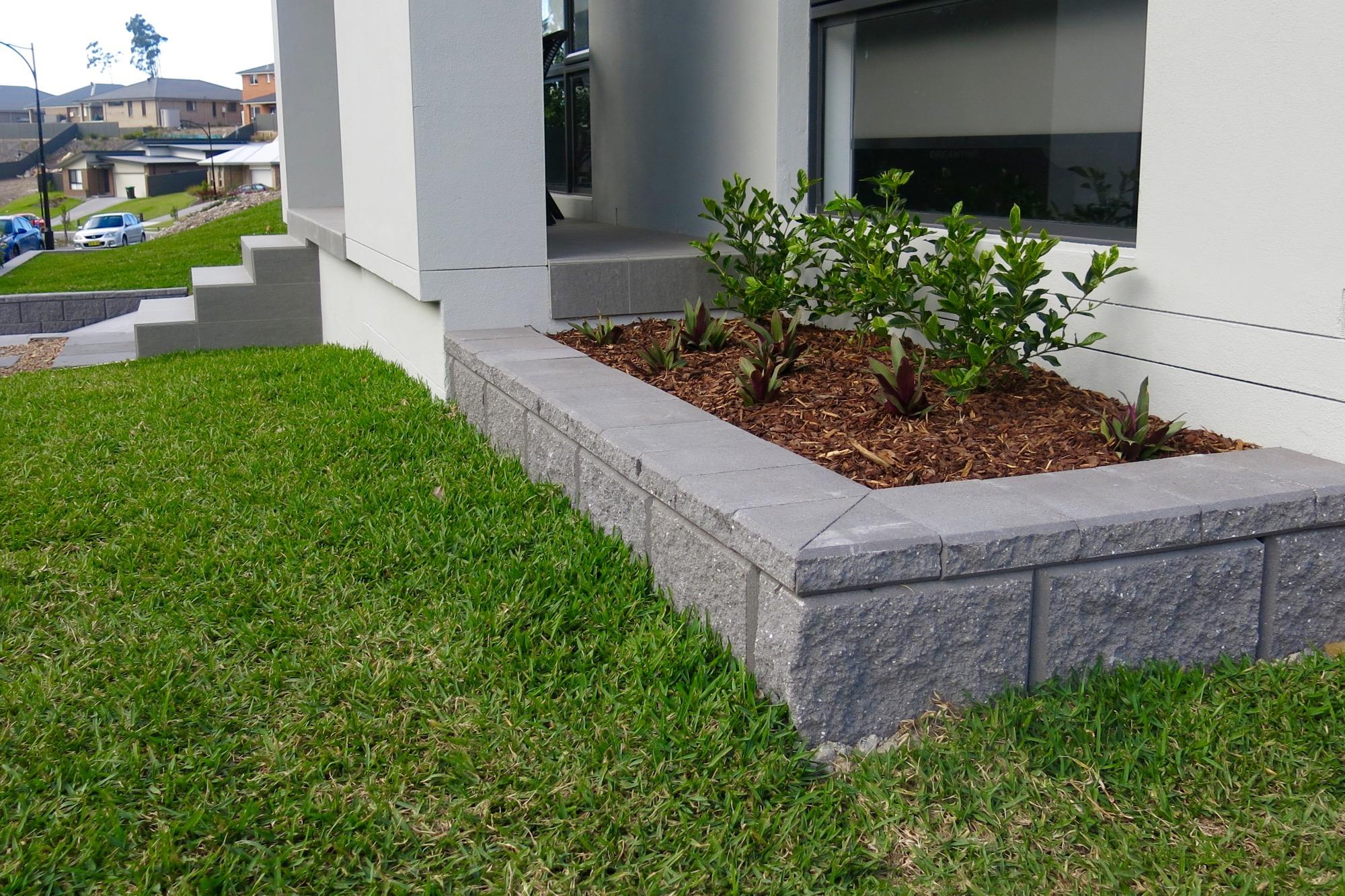 Tasman Block edging and small garden bed in Fletcher