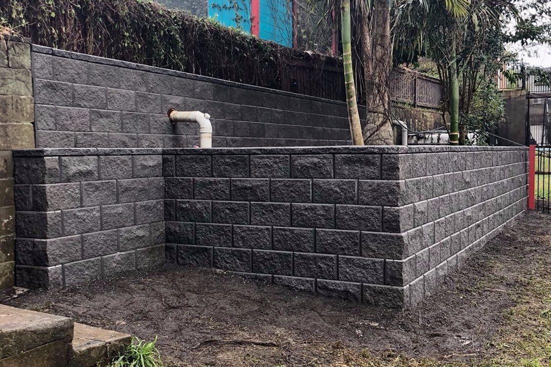 Tasman block wall on a steep block in Cardiff heights
